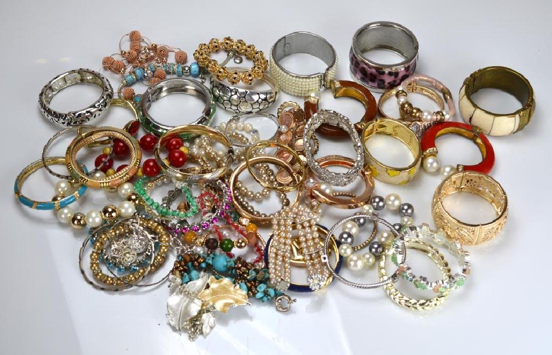 Large lot of costume bangles and bracelets