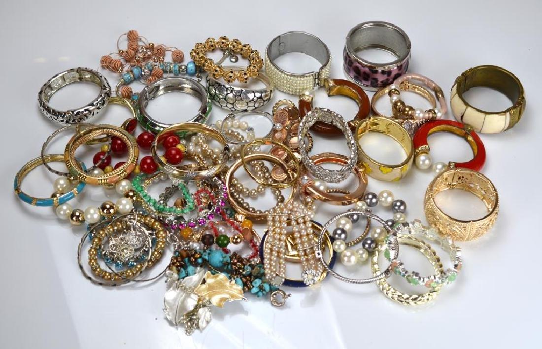 Large lot of costume bangles and bracelets