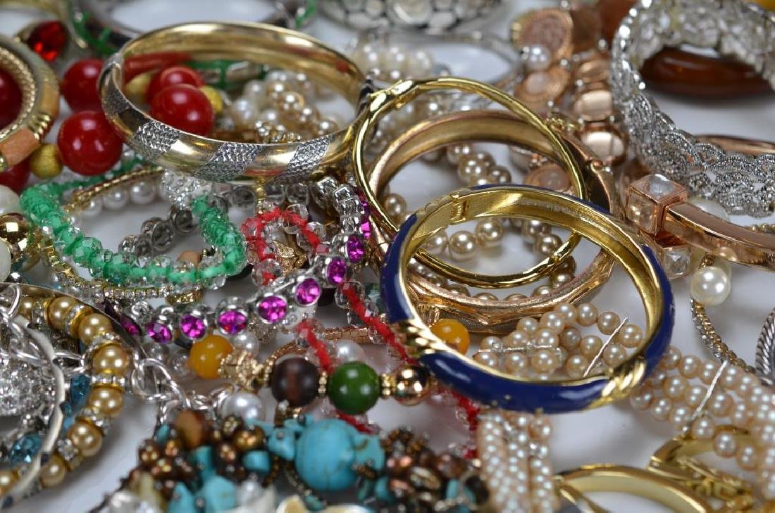 Large lot of costume bangles and bracelets - 2