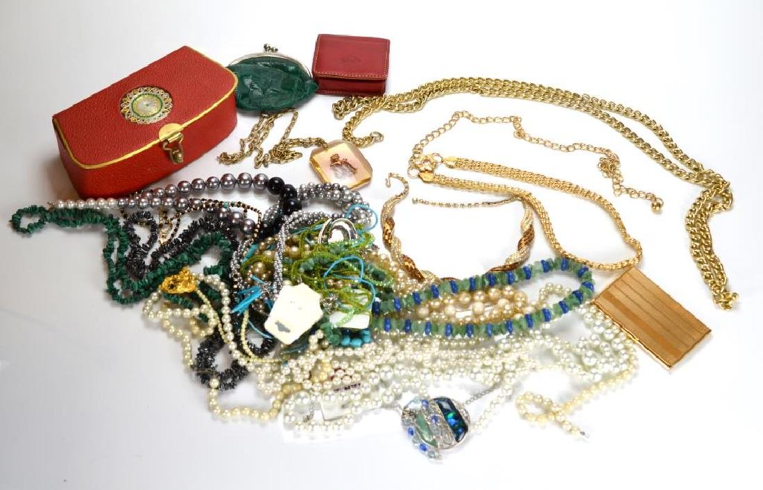 Large lot of costume necklaces and a card case