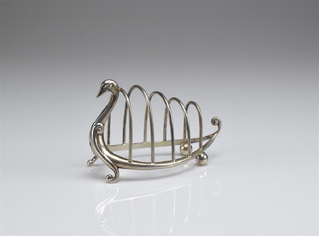 English silver figural swan form toast rack