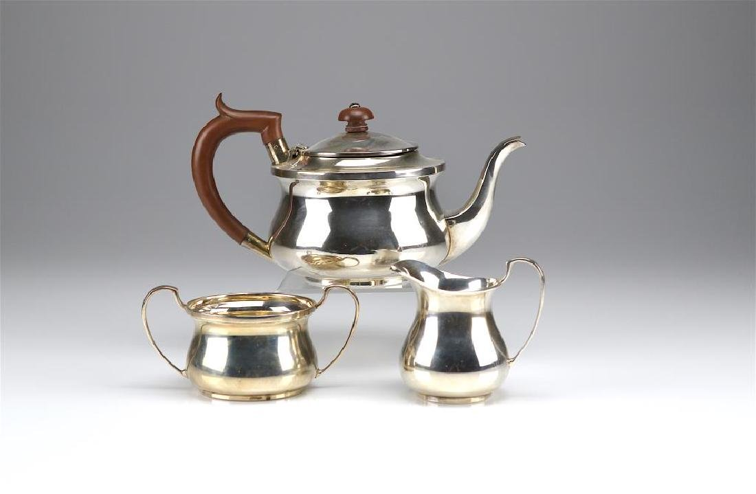 Three piece English silver tea set