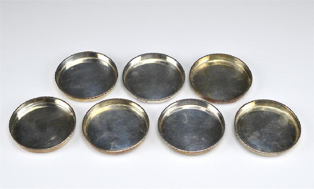 Seven Canadian Carl Poul Petersen silver coasters