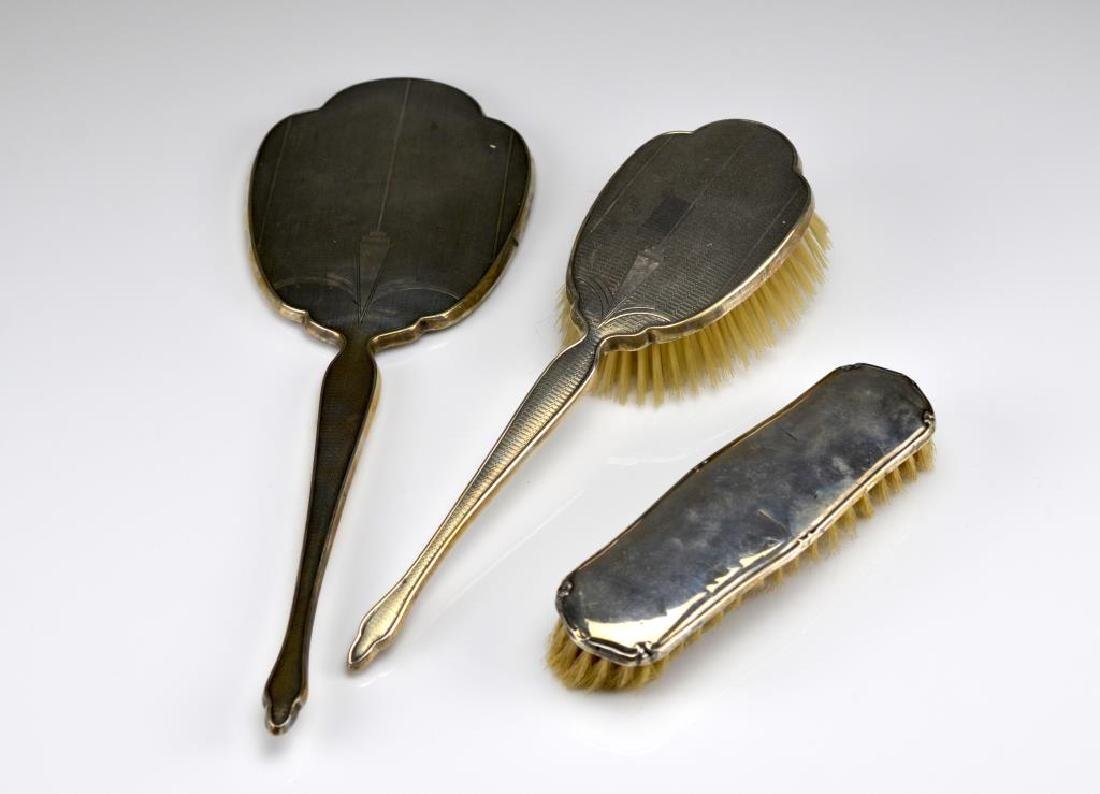 Three silver vanity pieces