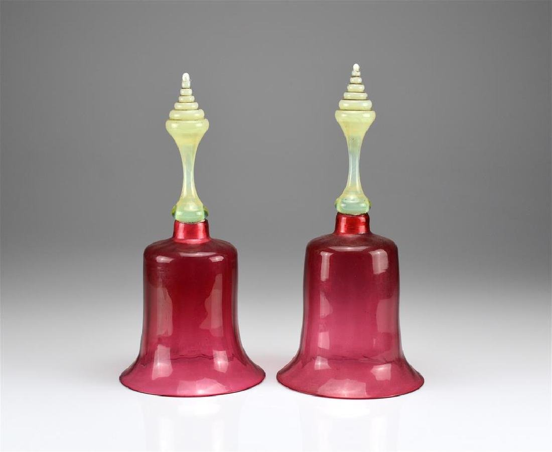 Two cranberry glass Victorian wedding bells