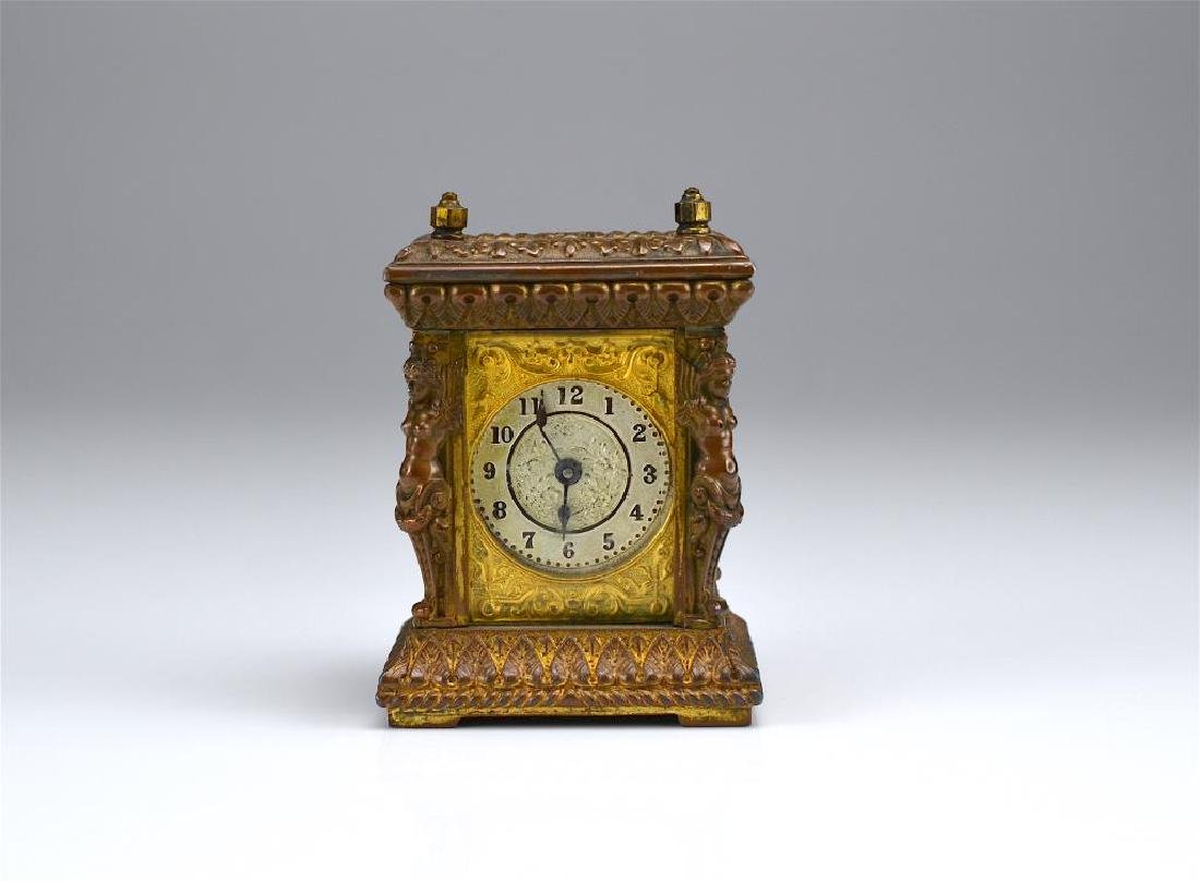 Antique patinated metal miniature mantel clock