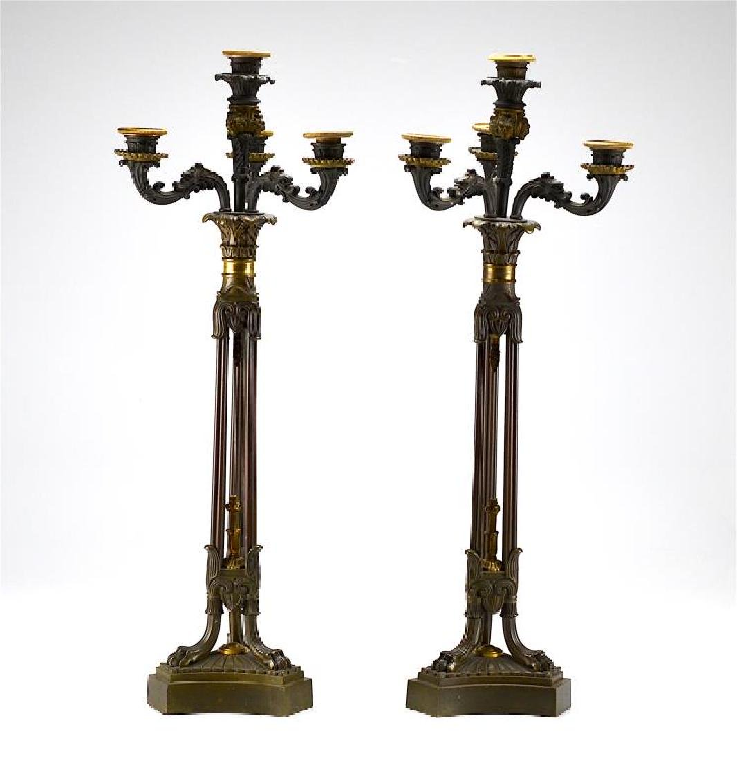 Pair of patinated French bronze candelabra