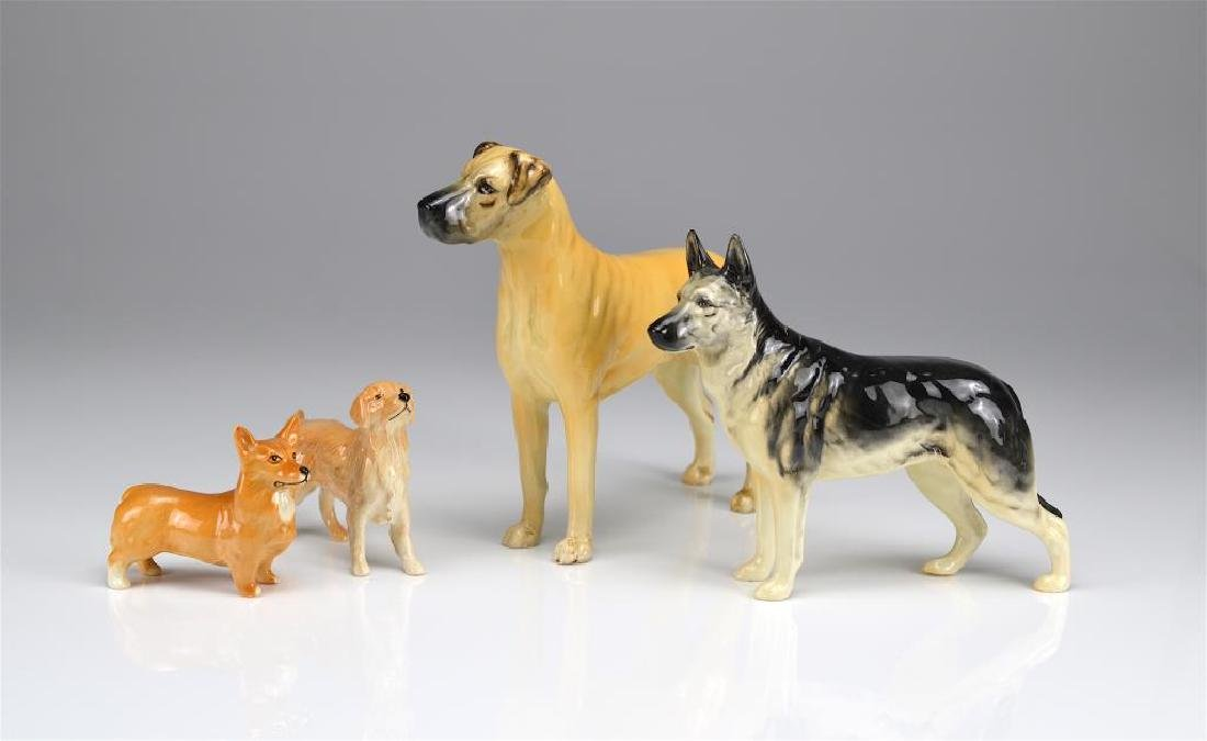 Four Beswick England dog figures
