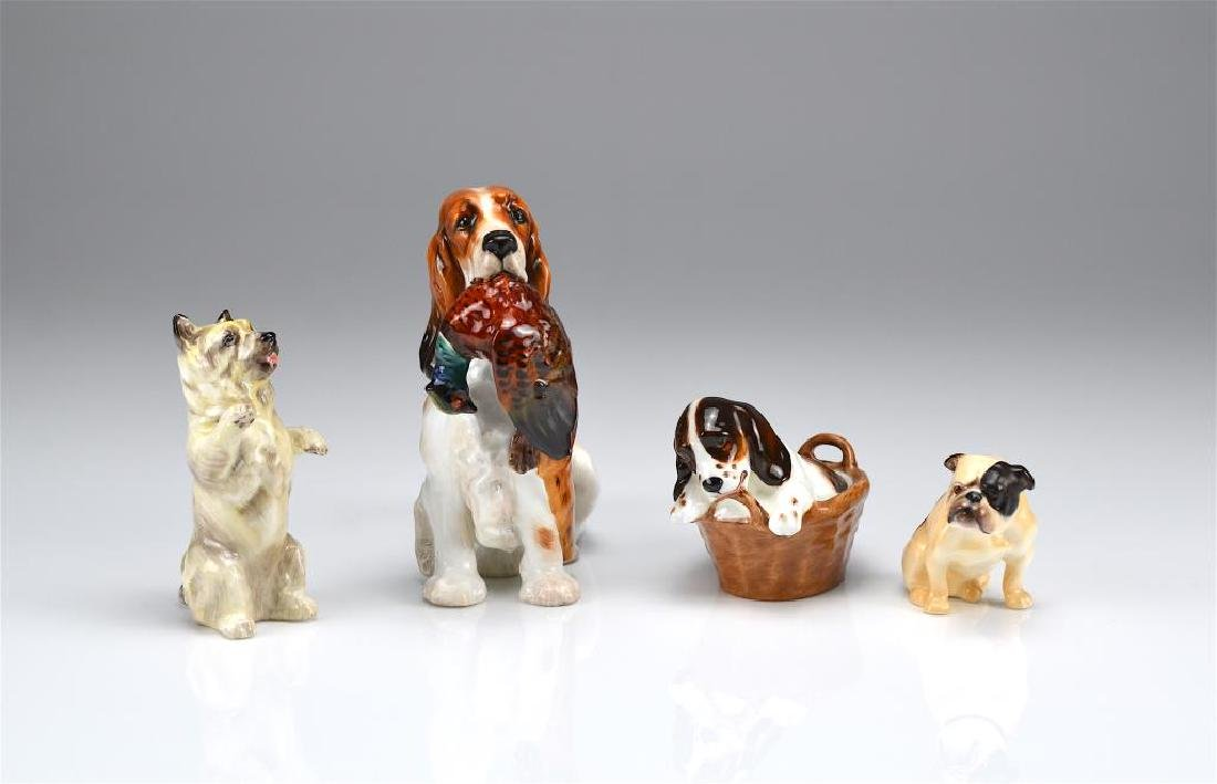 Four Royal Doulton dog figures