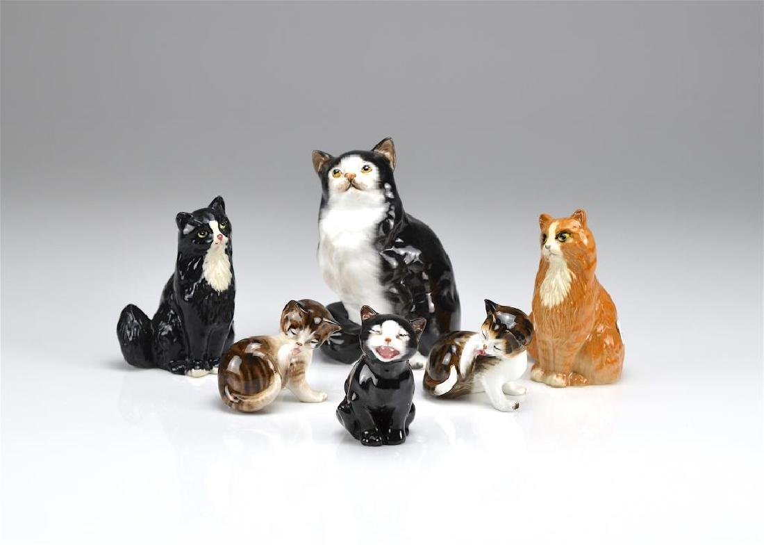 Six Royal Doulton cat figures