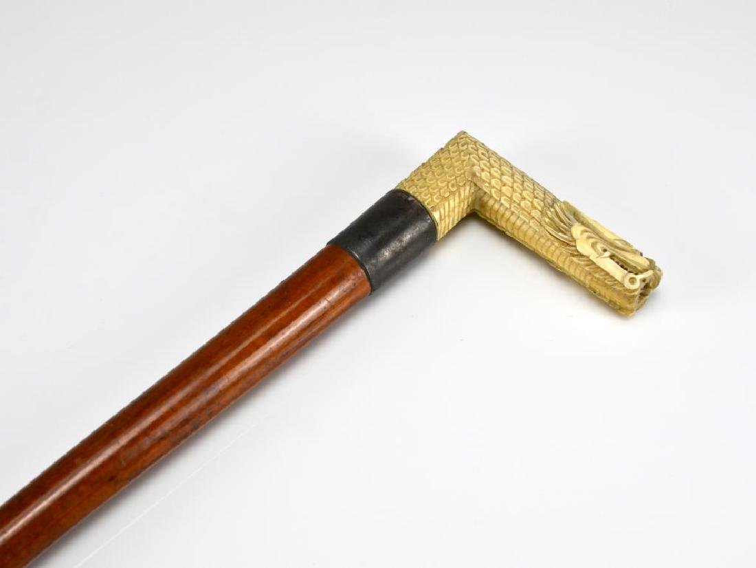 Wood cane w/ Chinese carved dragon form handle