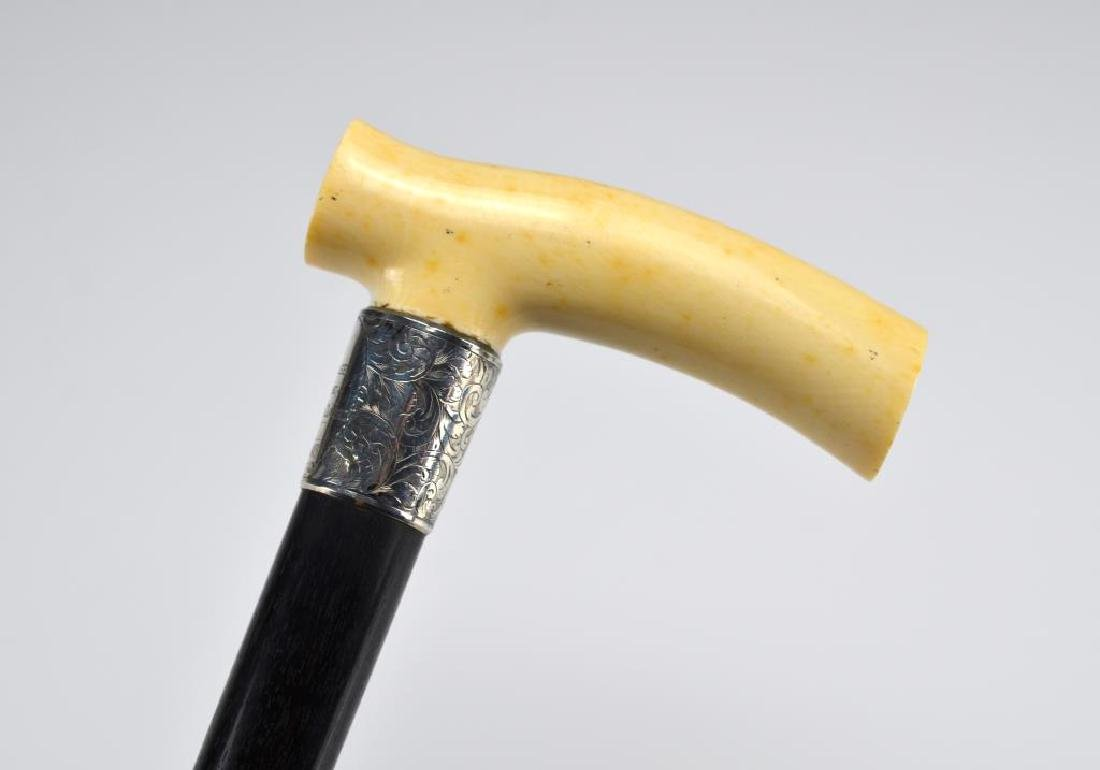 Walking stick with carved ivory handle