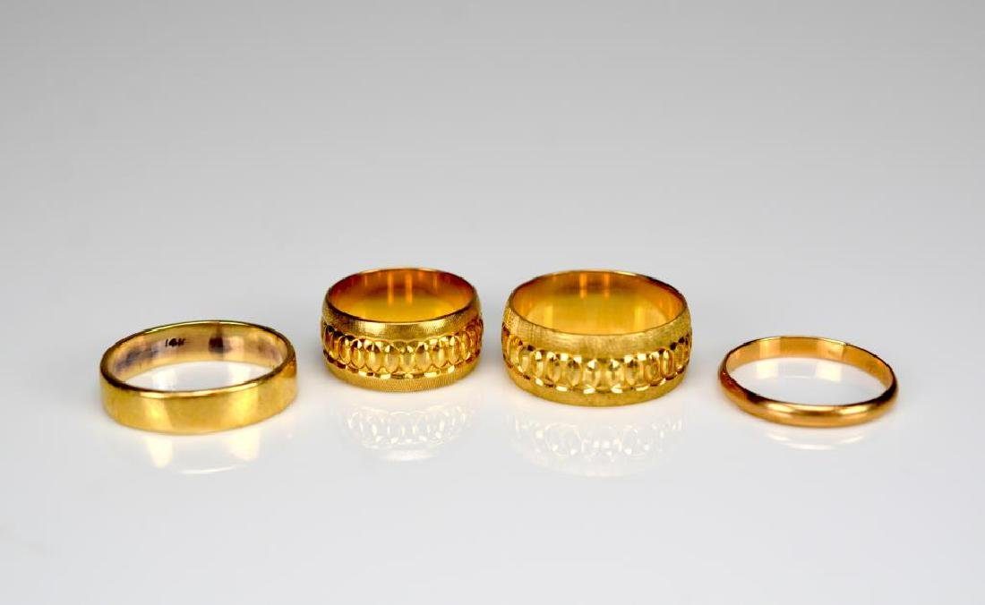 Four 14k yellow gold ring bands