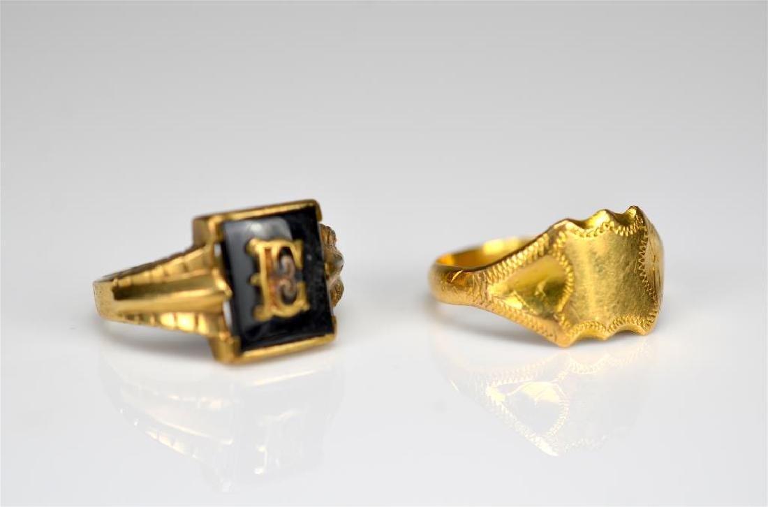 Two gold men's signet rings