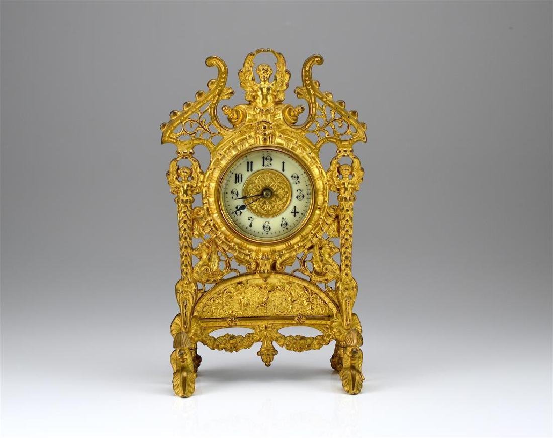 Ornate gilt metal mantel clock