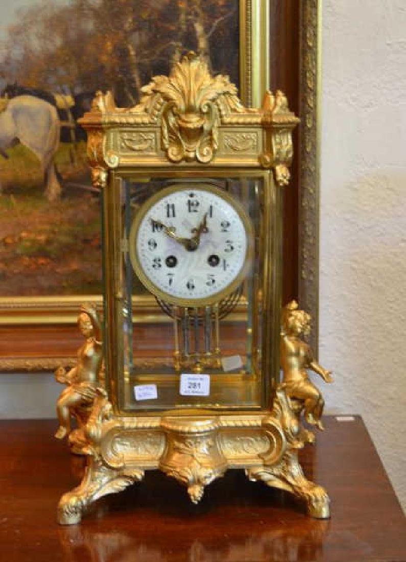 Gilt metal mantel clock w/ enamel dial