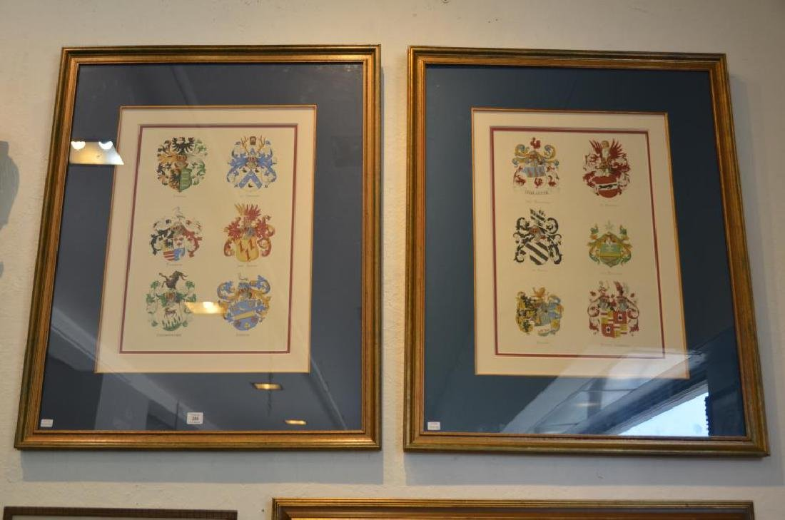 Pair of framed prints of armorial crests