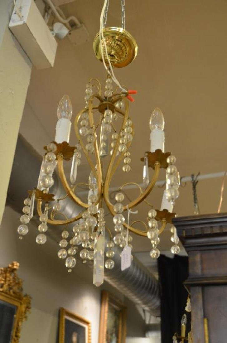 Two gilt metal chandelier with drops