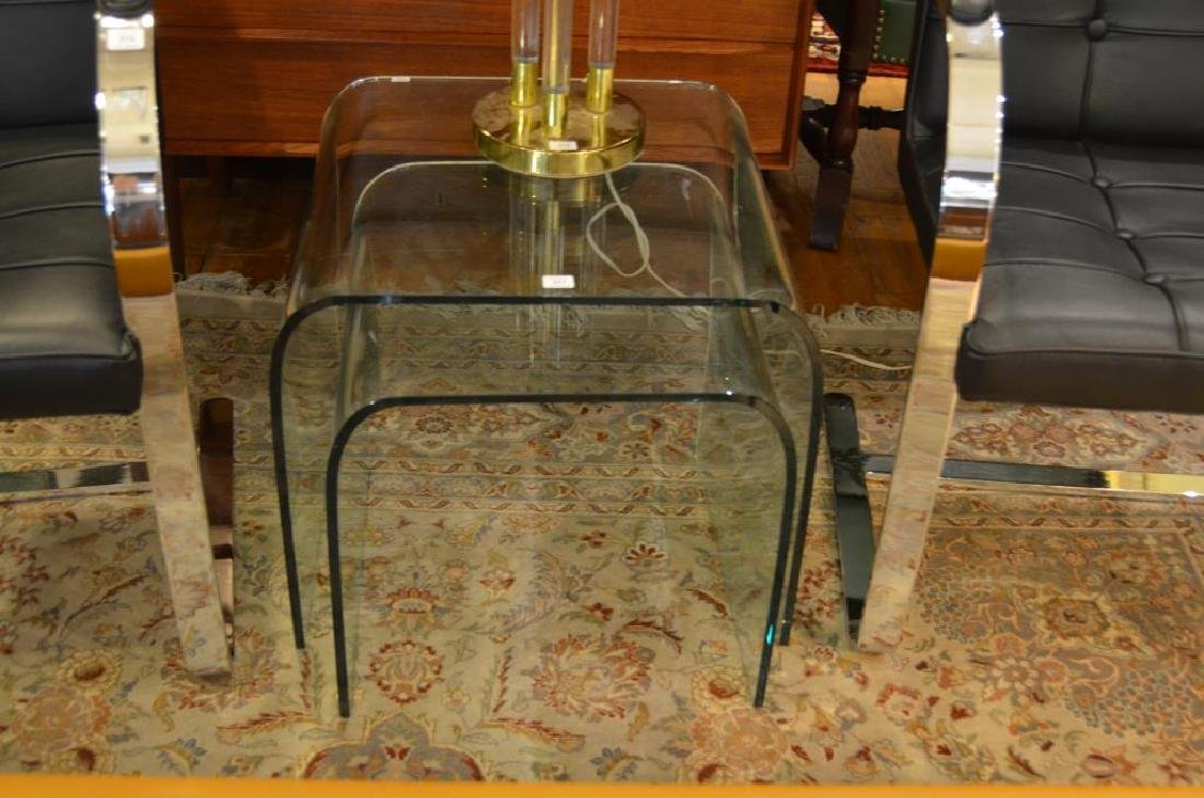 Two glass waterfall nesting tables