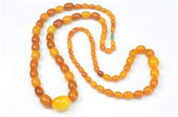 TWO NATURAL AMBER BEADED NECKLACES