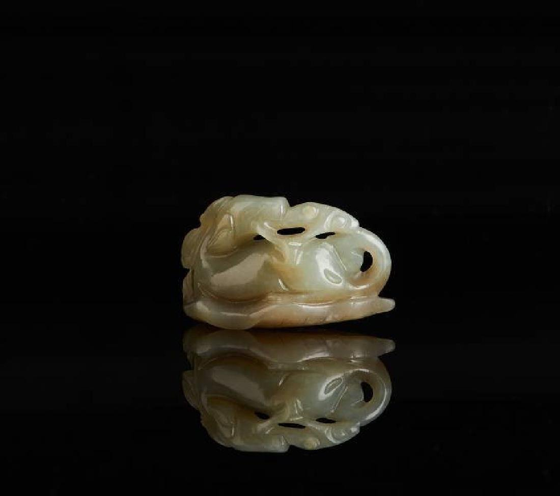 CHINESE CELADON JADE CARVED BEAST WITH LINGZHI