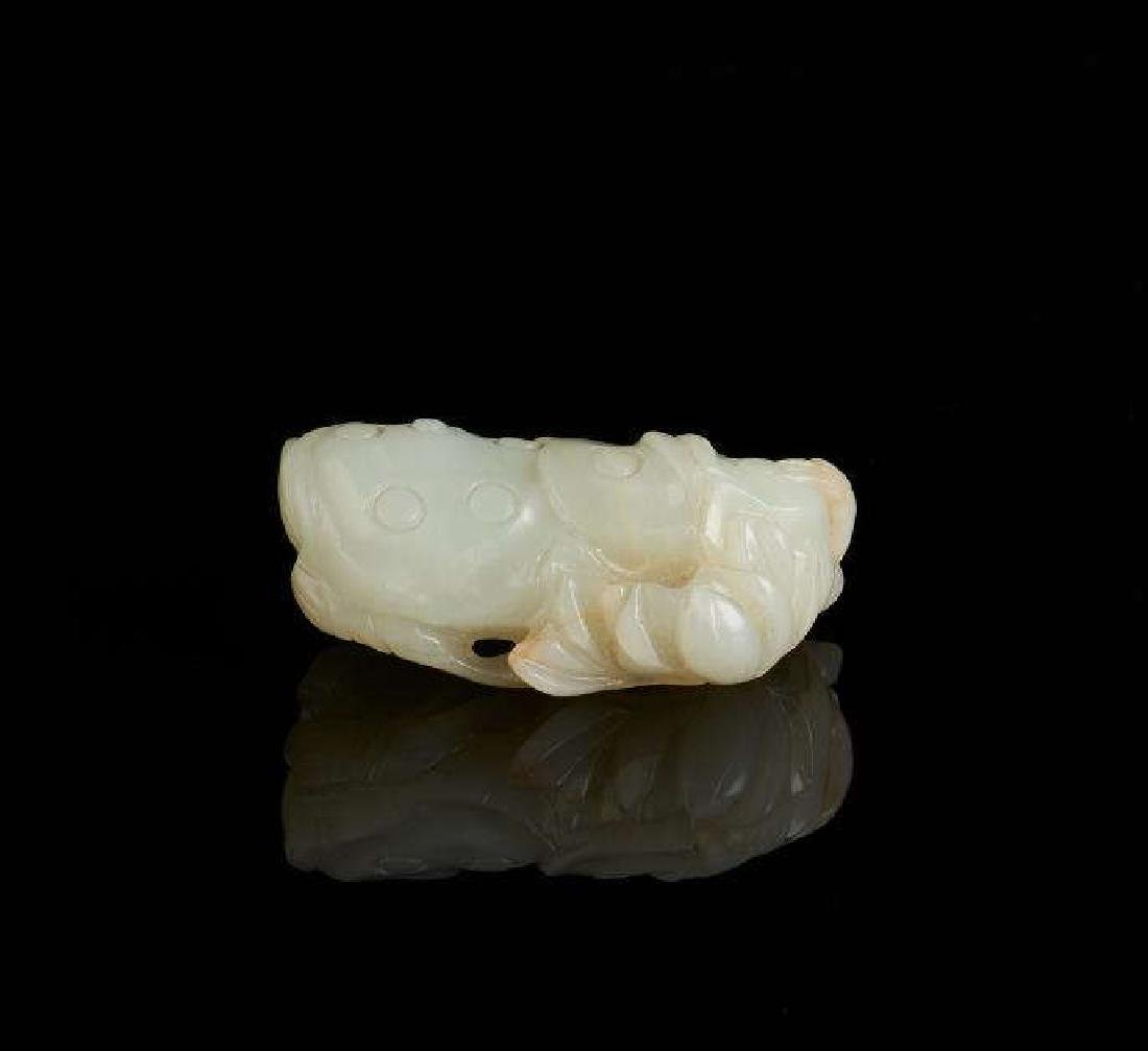 CHINESE CARVED WHITE JADE LOTUS GROUP