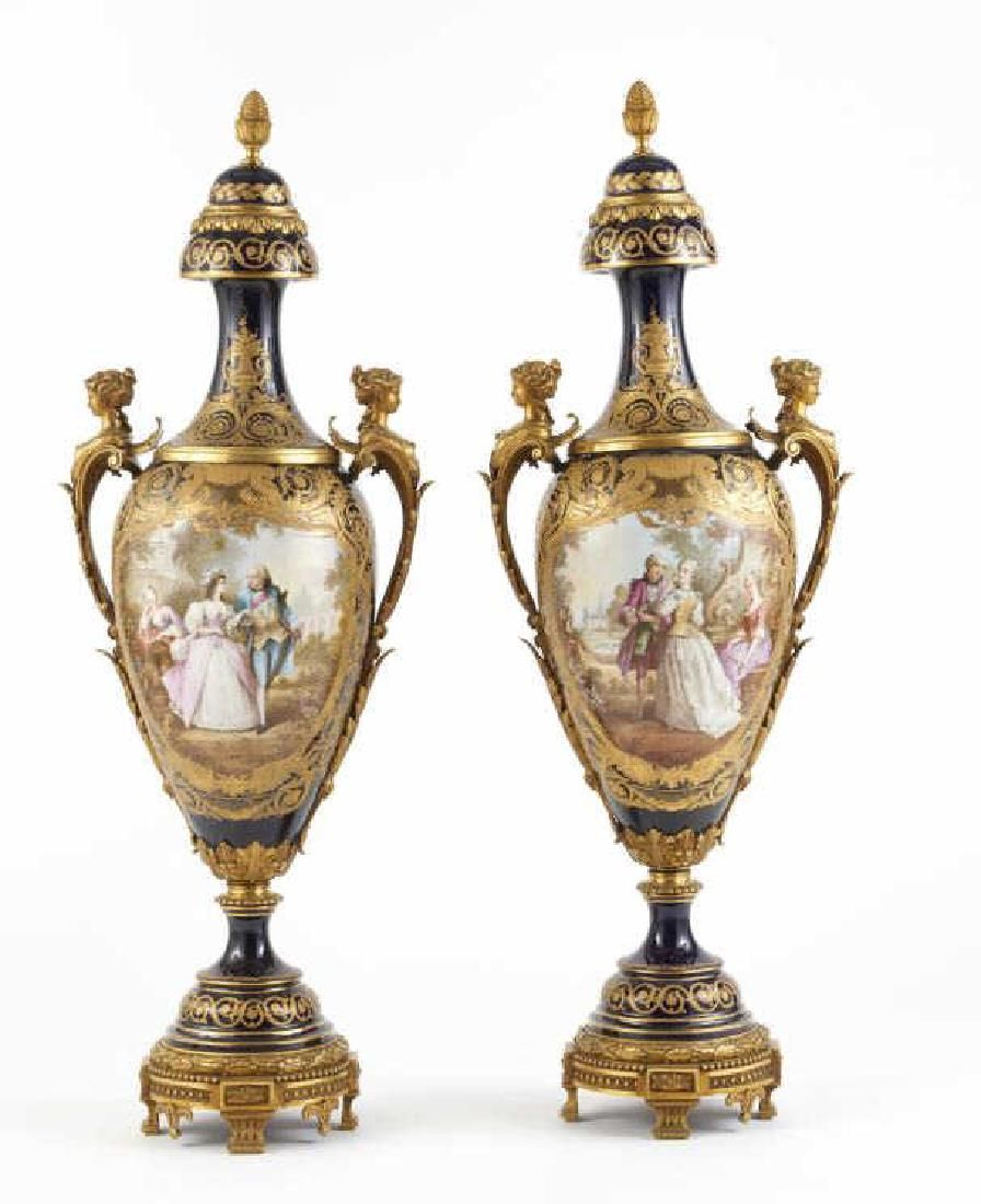 A MONUMENTAL PAIR OF FRENCH PORCELAIN URNS
