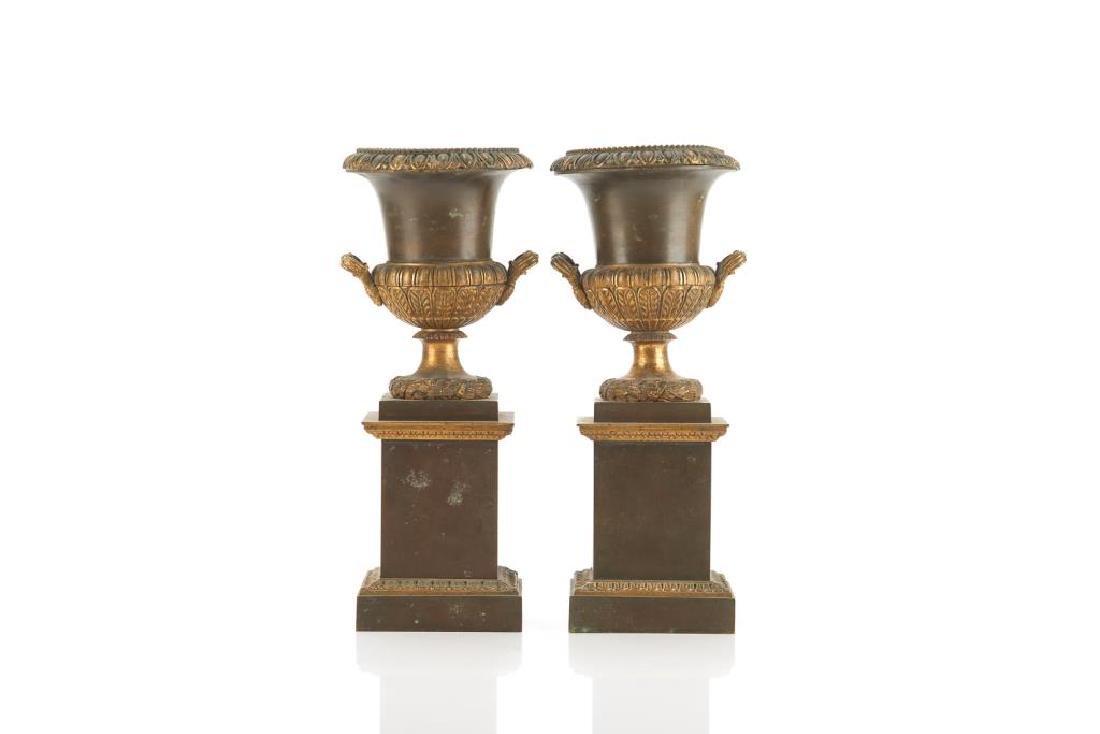 Pair of bronze urn garnitures