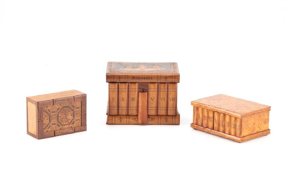 Three decorative carved wood secret boxes