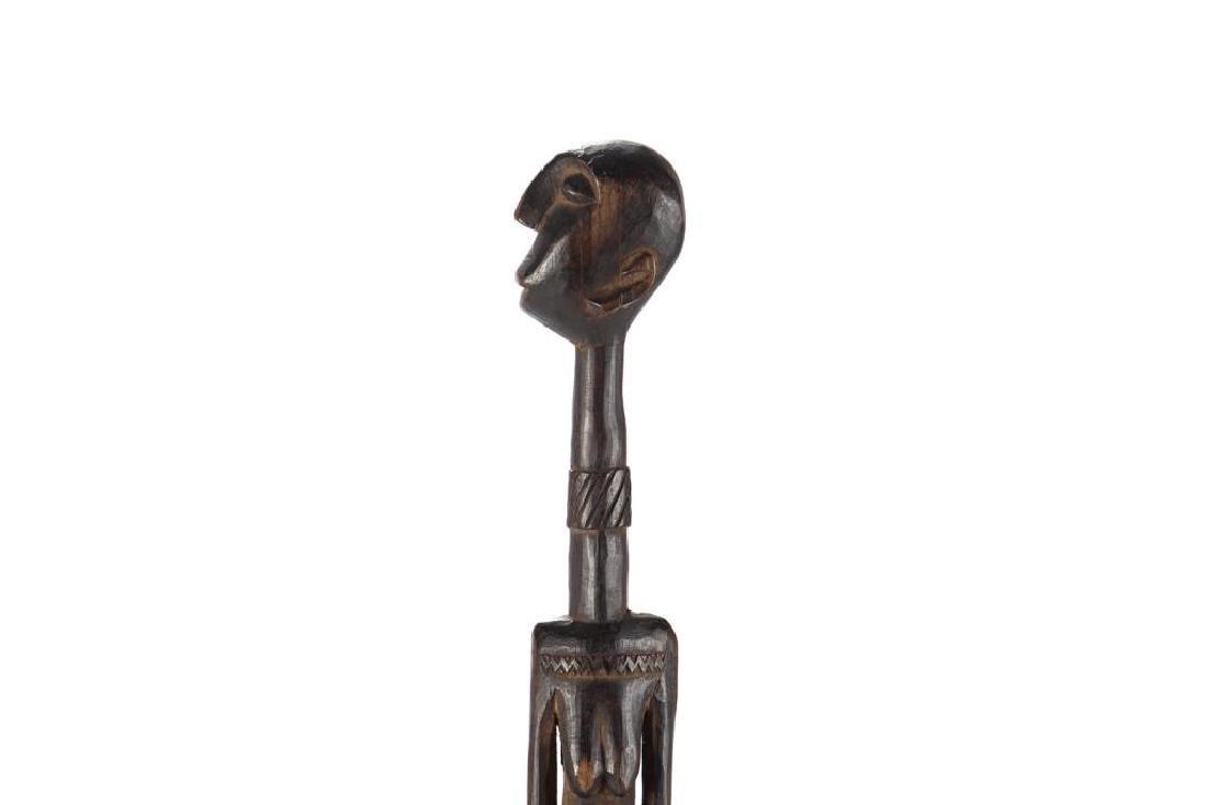 African wood elongated standing female figure - 4