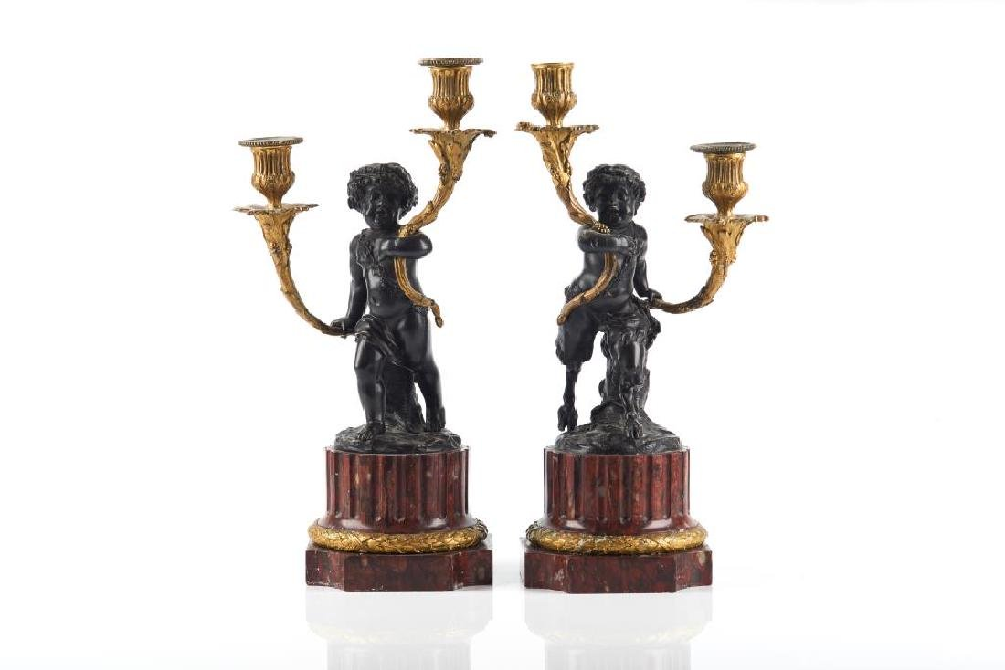 PAIR OF TWO TONE FIGURAL BRONZE CANDELABRA