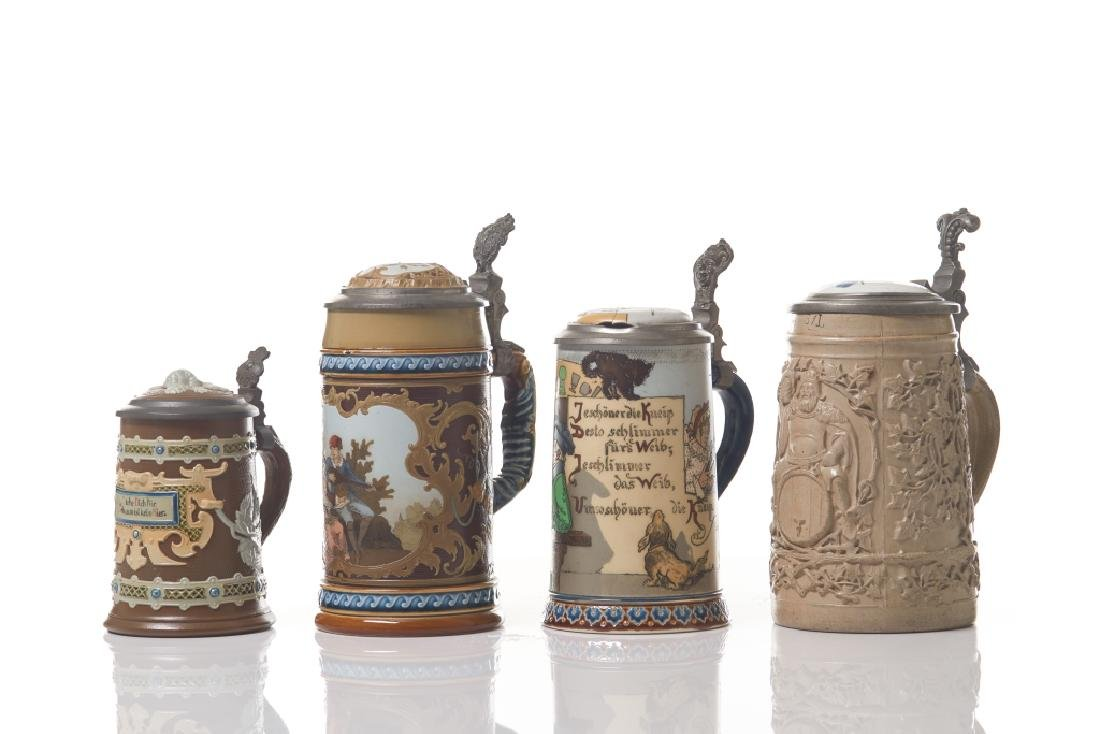 A GROUP OF ASSORTED ANTIQUE GERMAN DRINKING STEINS