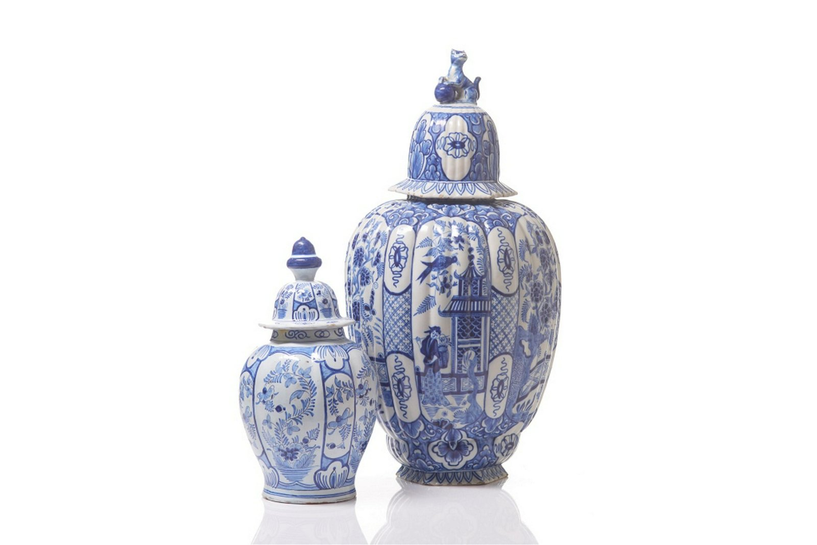 TWO BLUE & WHITE DELFT POTTERY COVERED VASES