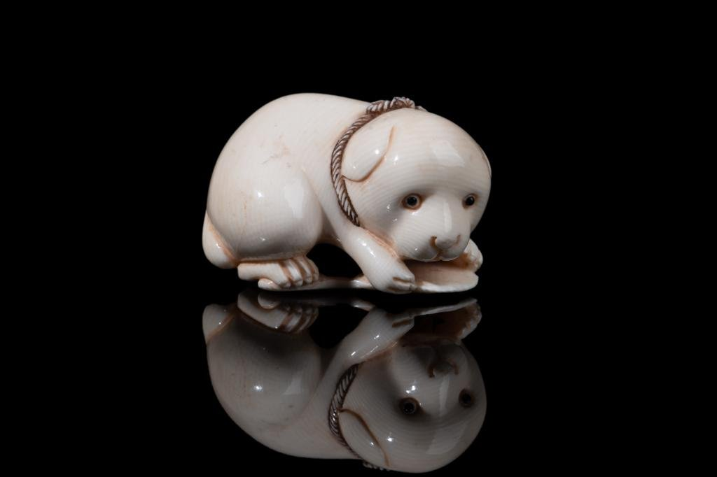 JAPANESE NATURAL CARVED NETSUKE OF PUPPY