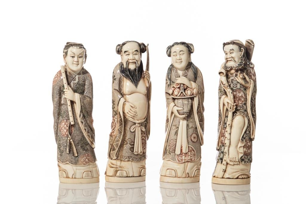 FOUR NATURAL CARVED CHINESE IMMORTAL FIGURES