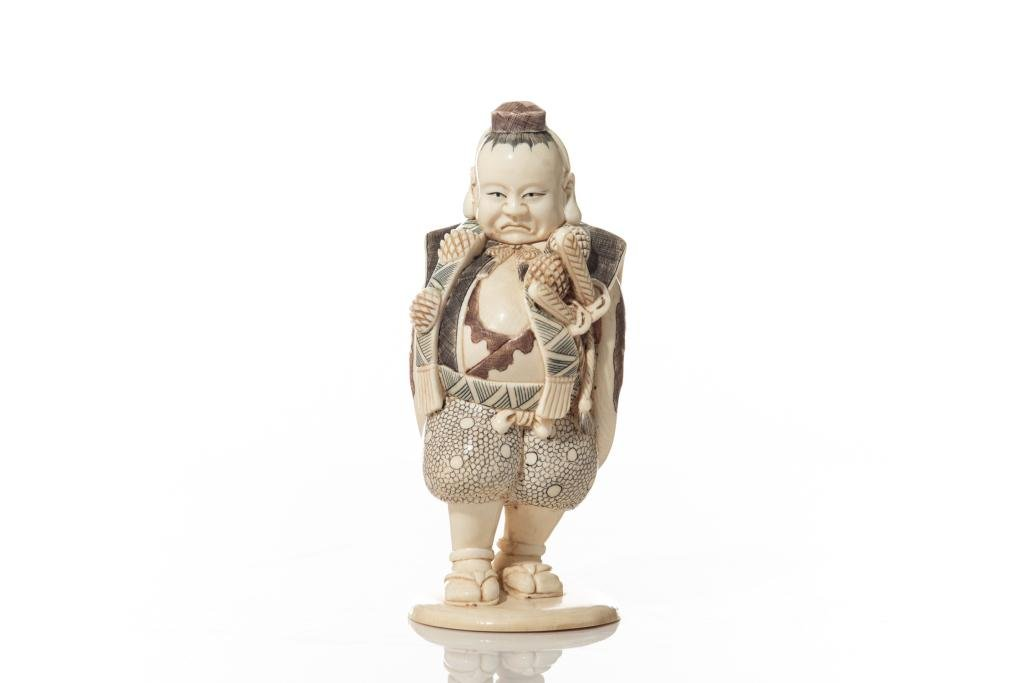 JAPANESE STAINED NATURAL CARVING OF A MAN