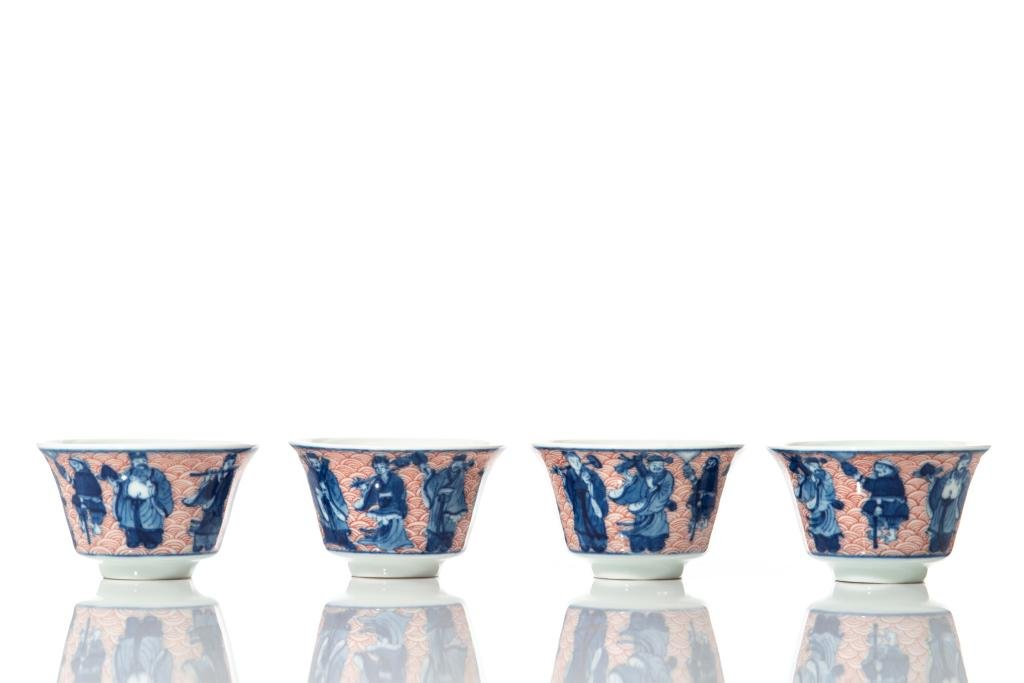FOUR COPPER RED, BLUE & WHITE PORCELAIN CUPS