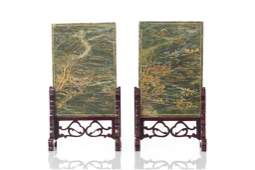 TWO GOLD PAINTED STONE TABLE PLAQUES ON WOOD STAND