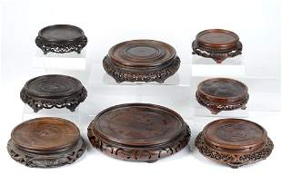 GROUP OF EIGHT CARVED CHINESE WOOD STANDS