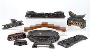 NINE ASSORTED CHINESE CARVED HARDWOOD STANDS