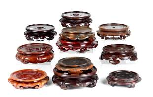 ELEVENT CHINESE CARVED HARDWOOD CIRCULAR STANDS
