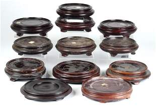 GROUP OF TWELVE CHINESE CIRCULAR WOOD STANDS