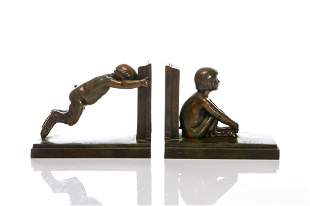 PAIR OF ART DECO PATINATED BRONZE FIGURAL BOOKENDS