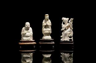 THREE CHINESE NATURAL CARVED FIGURES