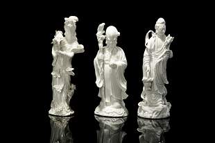 THREE CHINESE BLANC DE CHINE PORCELAIN FIGURES