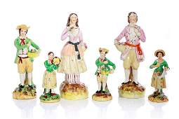 SIX STAFFORDSHIRE POTTERY FIGURES