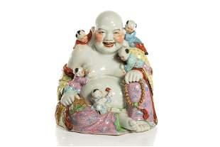 FAMILLE ROSE PORCELAIN SEATED BUDDHA