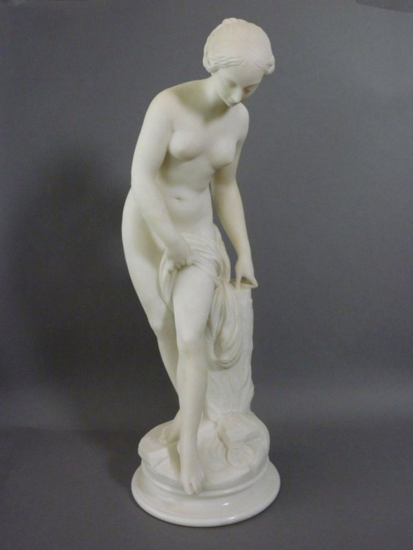 1017: WHITE MARBLE SCULPTURE OF A YOUNG FEMALE NUDE