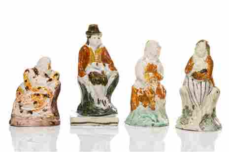 FOUR EARLY STAFFORDSHIRE PEARLWARE POTTERY FIGURES
