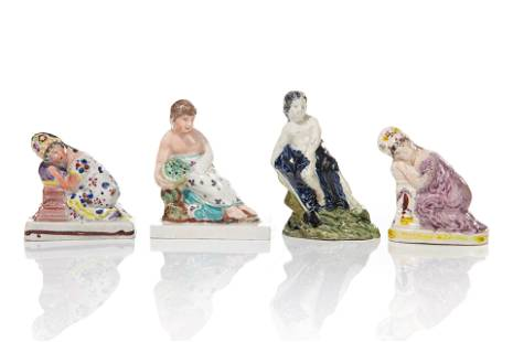 FOUR EARLY STAFFORDSHIRE POTTERY FIGURES